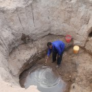 ASCP-Fr Katete. getting water from an open well in Chama